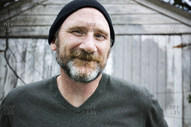 Close-up portrait of smiling man wearing knit hat