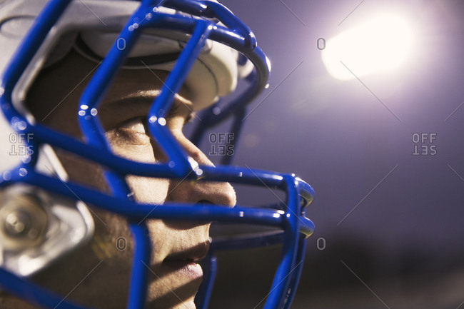 Close-up of American football player looking away
