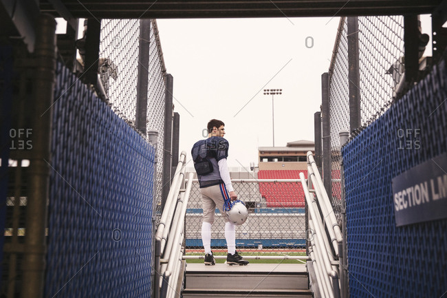 Low angle view of American football player standing at stadium seen through entrance