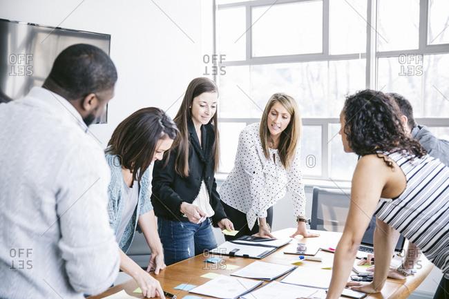 Business people brainstorming in board room