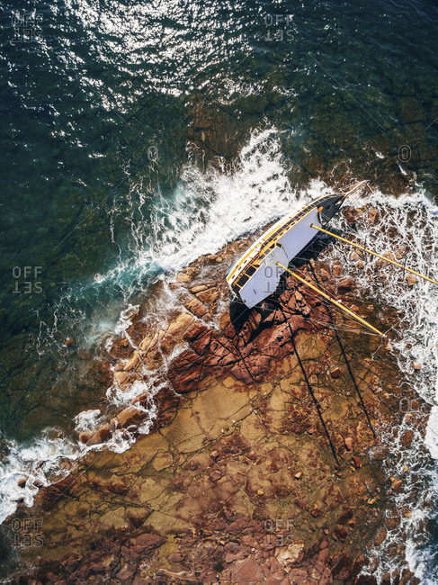 Overhead view of abandoned sailboat on shore