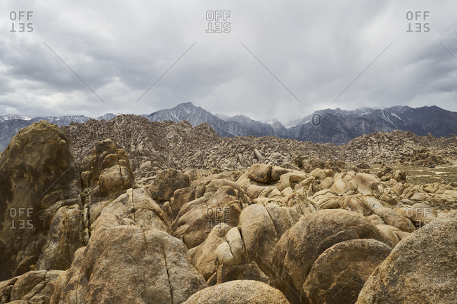 Scenic view of Alabama Hills against cloudy sky