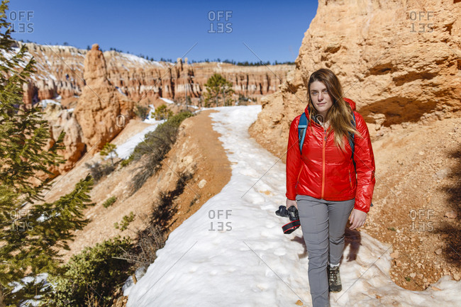 Portrait of hiker walking on snow covered mountain at Bryce Canyon National Park