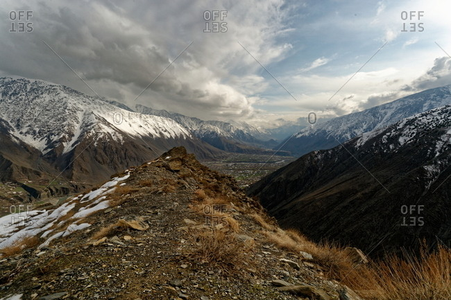 Clouds moving in over river valley in mountains of Pakistan