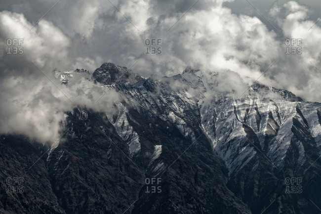 Snowstorm clouds converge on mountain in Pakistan