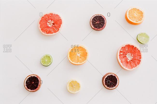 Citrus fruit slices on white background