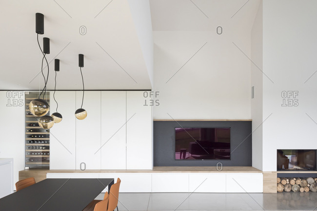 View of dining table and fireplace in modern home