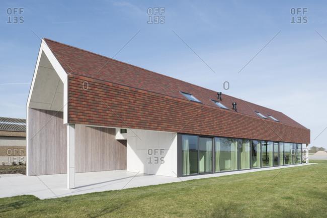 Long barn redesigned as a modern home in Flanders, Belgium