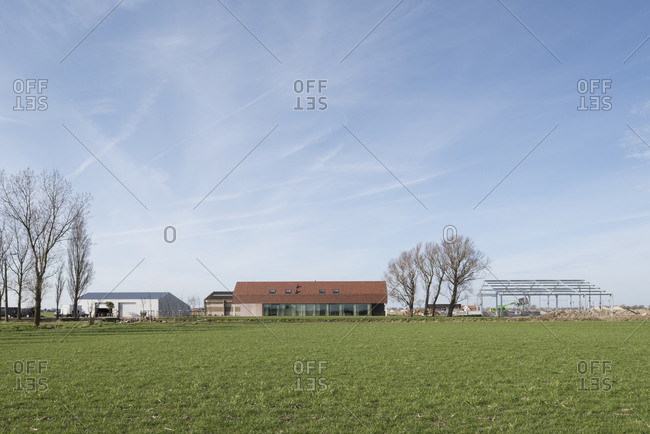 View of modern house with farm buildings in Flanders, Belgium