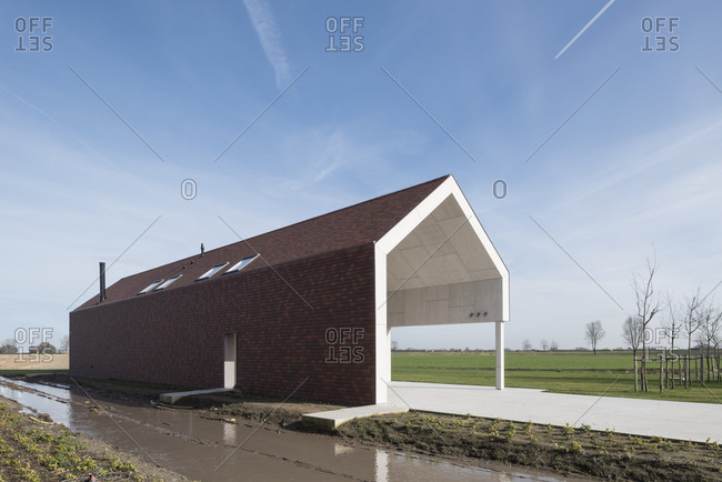 Barn renovated into a modern house in Belgian countryside