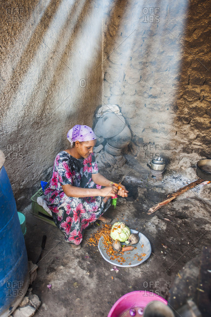 Asayta, Ethiopia - November 30, 2010: Woman preparing food in the kitchen of the Basha Amare Hotel
