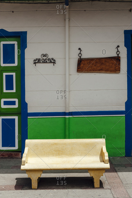 Cement bench between two colonial houses in the small town of Salento, Colombia