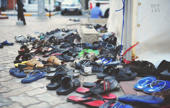Abu Dhabi, United Arab Emirates - July 27, 2014: Shoes in the streets of Abu Dhabi during Ramadan