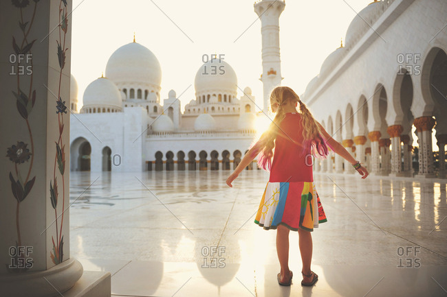 Abu Dhabi, United Arab Emirates - March 5, 2016: Girl at the Sheikh Zayed Mosque in Abu Dhabi