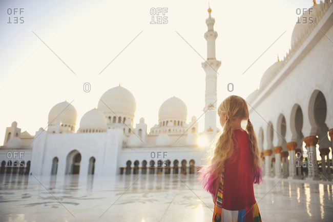 Abu Dhabi, United Arab Emirates - March 5, 2016: Girl visiting the Sheikh Zayed Mosque in Abu Dhabi