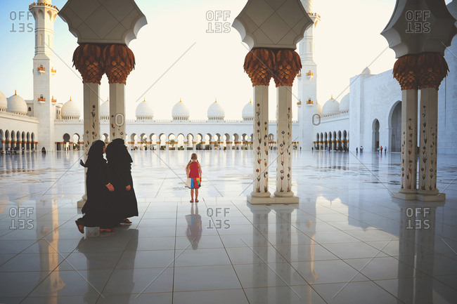 Abu Dhabi, United Arab Emirates - March 5, 2016: Child walking by Muslim women at the Sheikh Zayed Mosque Abu Dhabi