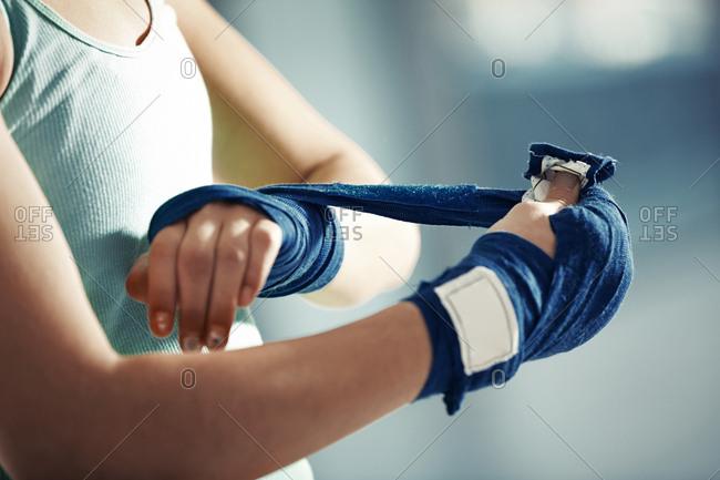 Sportswoman wrapping bondage
