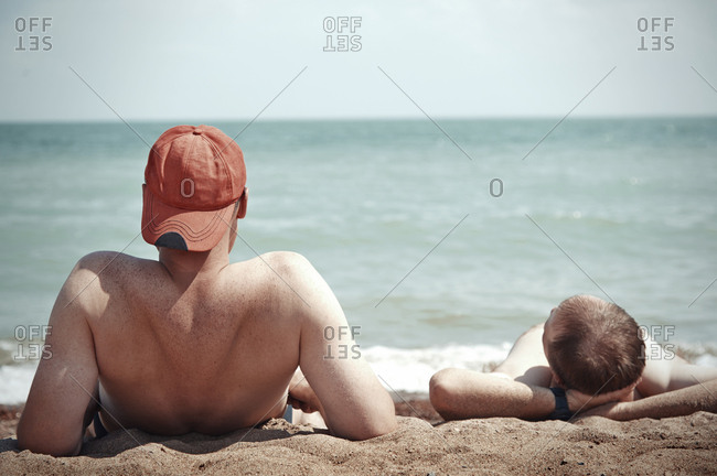 Two men relaxing at the beach