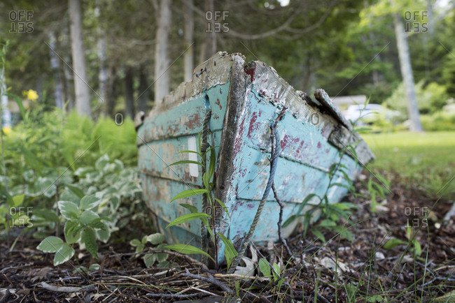 Weathered wooden boat on dry ground in Cushing, Maine