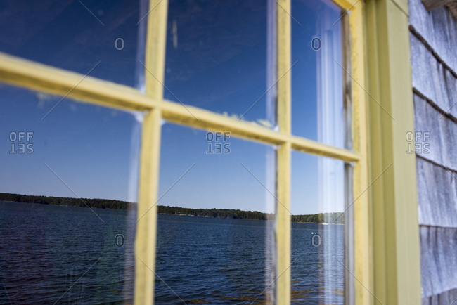 Coastline reflected in the window of a building in Cushing, Maine