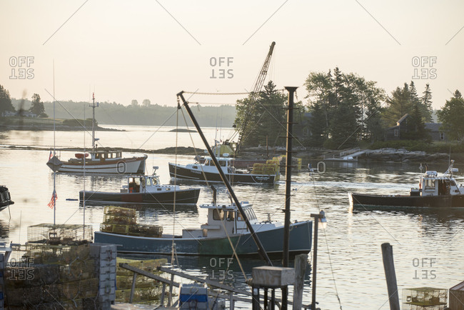 Cushing, Maine, USA - June 25, 2016: Several fishing boats with lobster traps in harbor