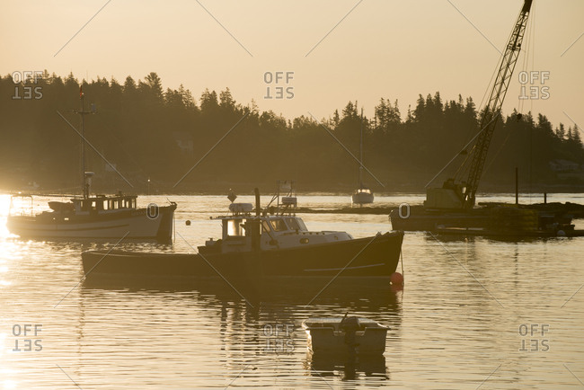 Cushing, Maine, USA - June 25, 2016: Several fishing boats in harbor