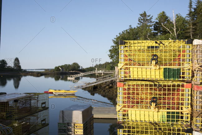 Cushing, Maine, USA - June 25, 2016: Lobster traps stacked on dock at harbor