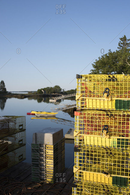 Cushing, Maine, USA - June 25, 2016: Lobster pots stacked on dock at harbor