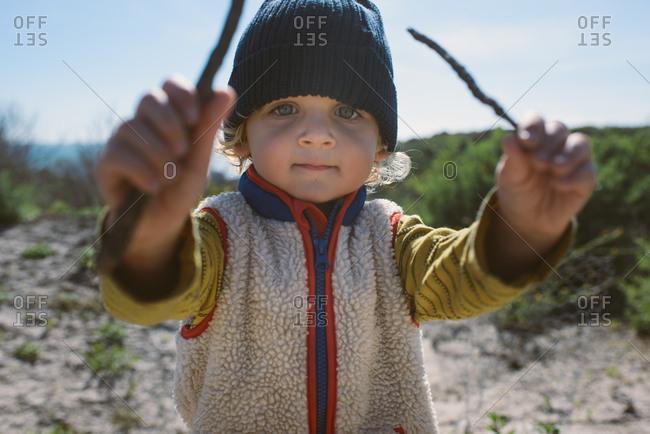Boy holding sticks