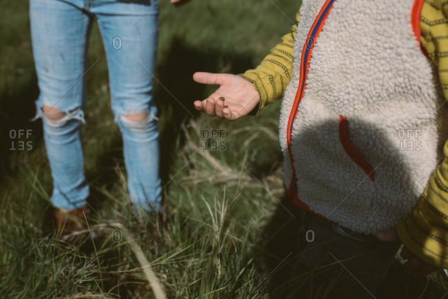 Kids holding ladybug