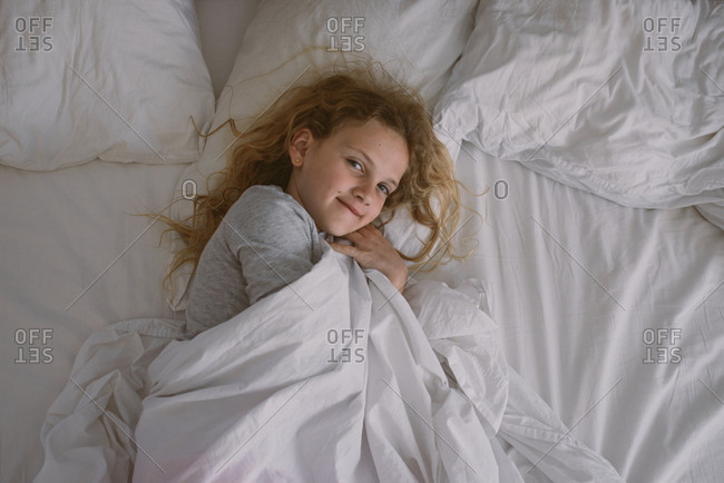 Girl waking up in bed