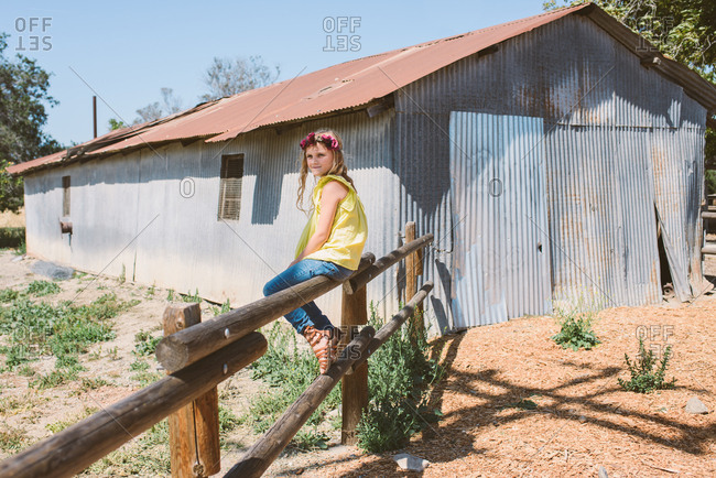 Girl on wood fence