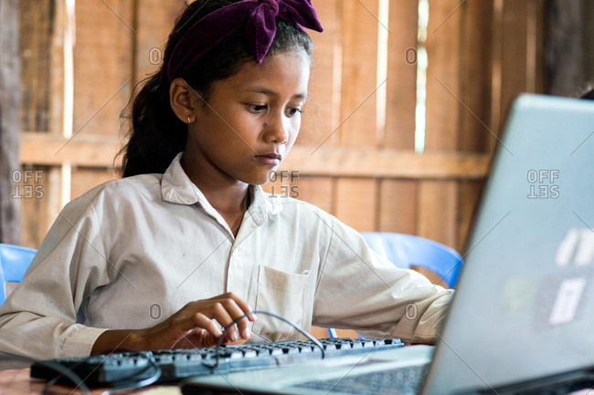Siem Reap, Cambodia - April 1, 2015: Student working on a computer