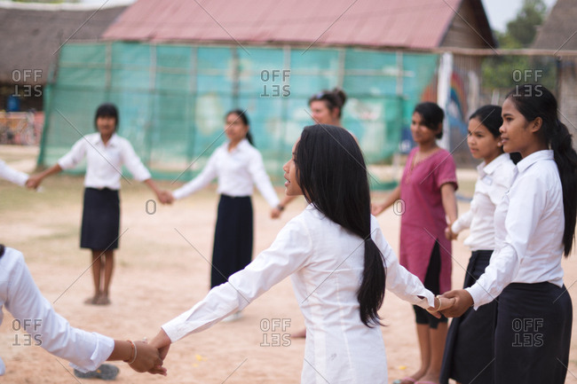 Siem Reap, Cambodia - April 1, 2015: Children playing games in the school yard