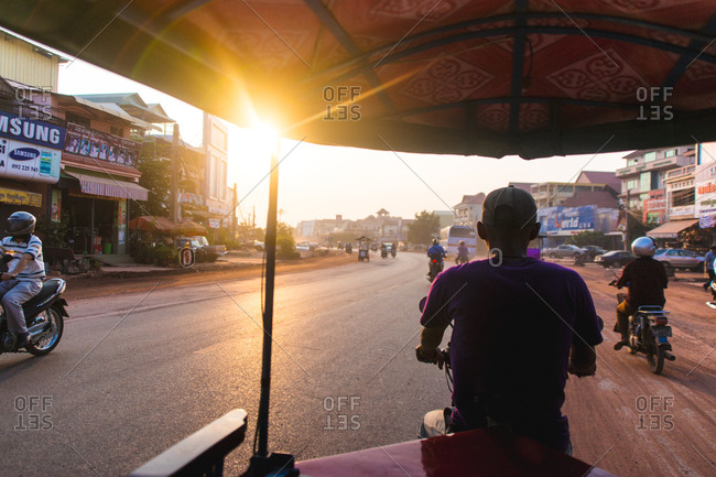 Siem Reap, Cambodia - April 1, 2015: Tuktuk ride at sunrise - Siem Reap, Cambodia