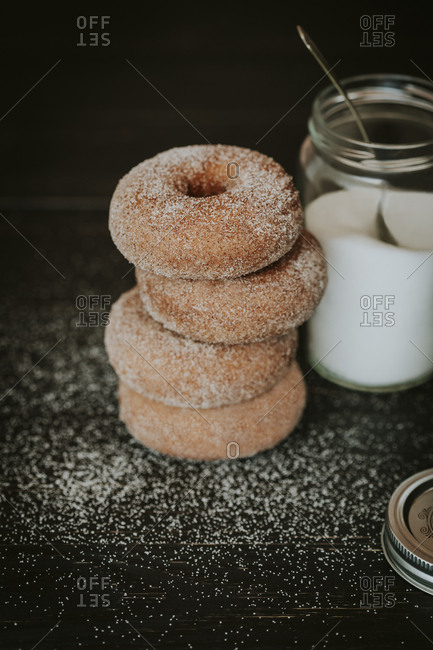 Cinnamon sugar donuts with sugar jar