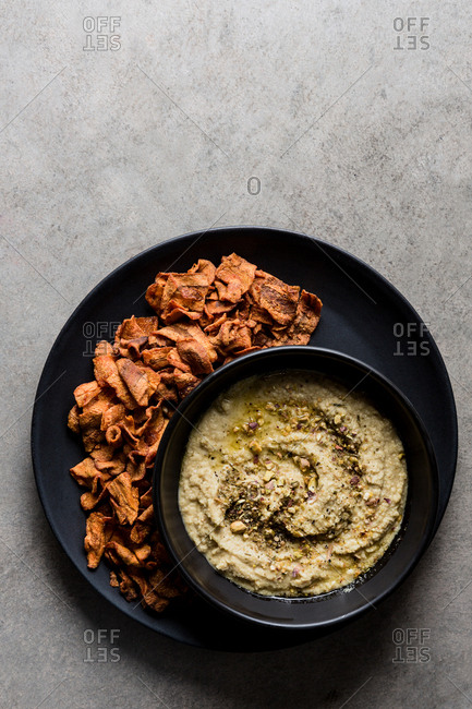 Hummus with carrot chips appetizer