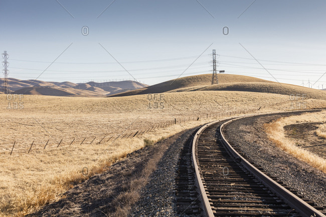 A railroad track travels through the foothills of the California Central Valley near Tracy, Ca.