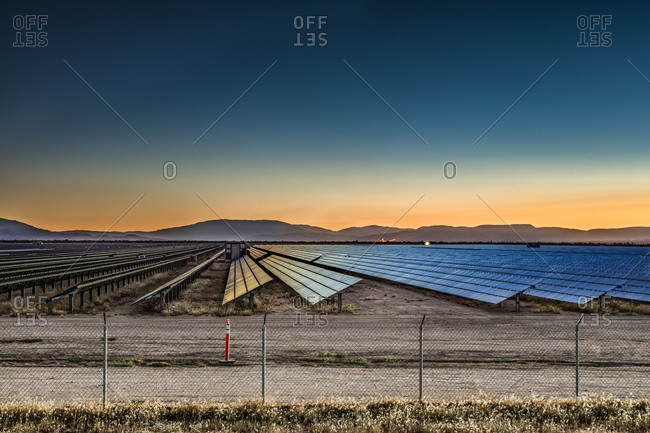 Renewable energy solar panels line the landscape of the Mojave Desert of California.
