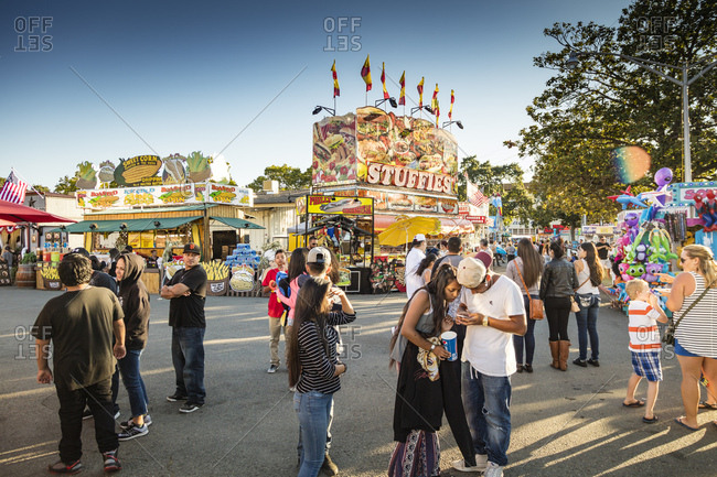 Sonoma County, California - July 27, 2016: A group of fair attendees congregate in the food pavilion of the Sonoma County Fair in summer.