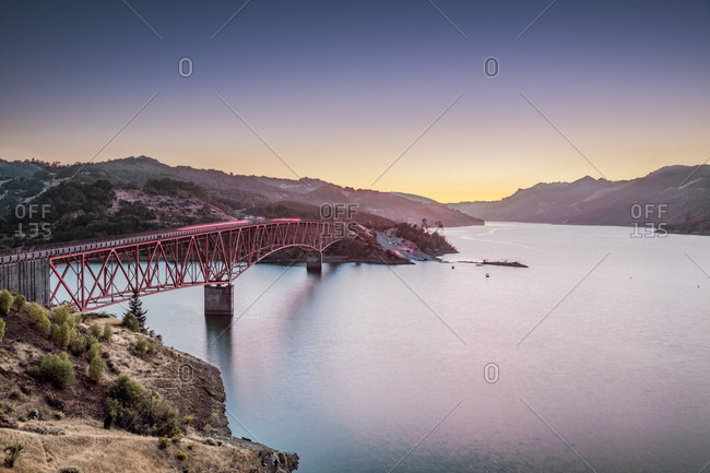 A bridge spans a portion of Lake Sonoma at dusk , in Sonoma County, just North of the town of Healdsburg, California.