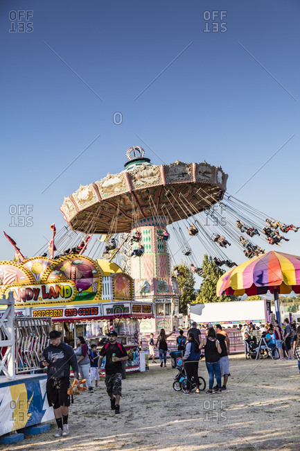 Sonoma County, California - July 27, 2016: Fair goers ride a spinning amusement park ride at the annual Sonoma County Fair in Northern California.