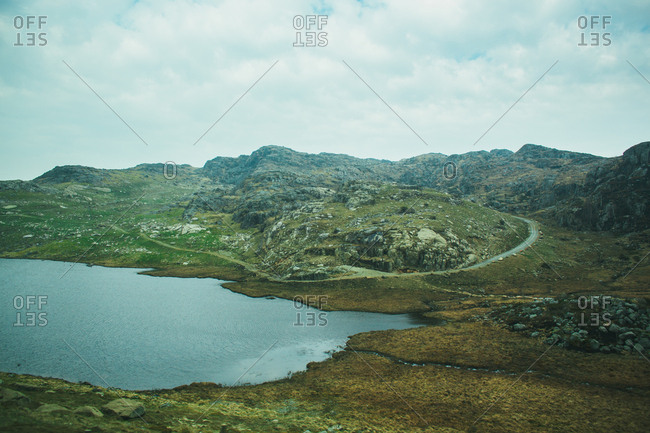 Mountain lake surrounded by green hills