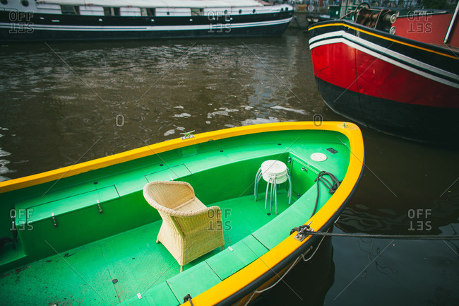 Bright green and yellow boat on the canal