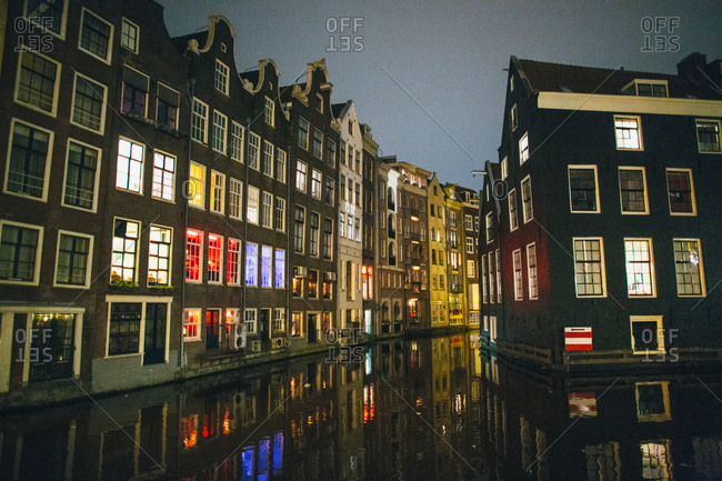 Red light district reflecting on the water