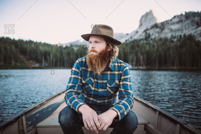 Portrait of a young man in a boat on a lake