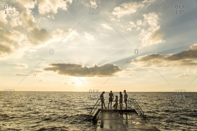 Friends standing on pier