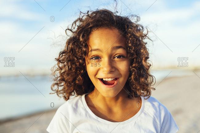 Portrait of brunette girl (10-11) on beach