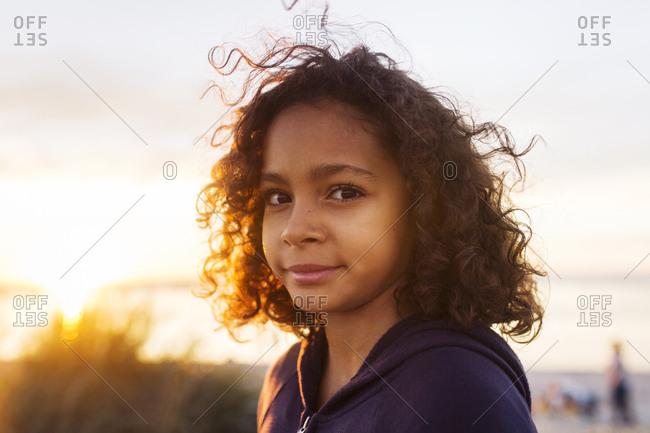 Portrait of brunette girl (10-11) at sunset
