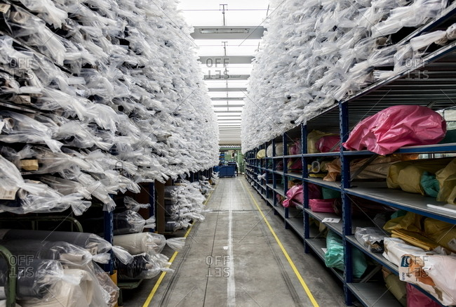 Valle Mosso, Italy - March 1, 2017: Shelves stacked with bags in an Italian textile factory